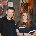 With a fan; Taken at a book signing for Day Soldiers